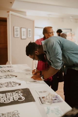 Emmaunel Adjei with His Work