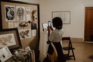Girl Photographing the work of Gossamer Rozen